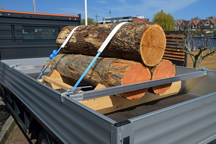 Wooden stumps on the truck. The stumps are secured by safety straps. Good protection of products in cargo area is the responsibility of the driver.