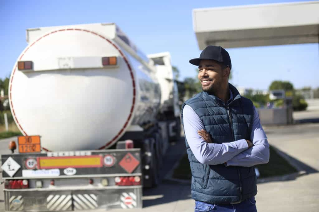 Fuel tanker driver on a gas station. About 35 years old, African male.